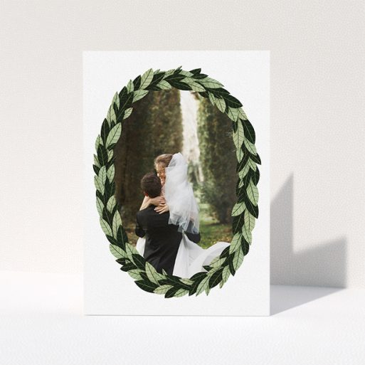"""A wedding thank you card design titled """"Thick Wreath Frame"""". It is an A5 card in a portrait orientation. It is a photographic wedding thank you card with room for 1 photo. """"Thick Wreath Frame"""" is available as a folded card, with tones of light green and dark green."""