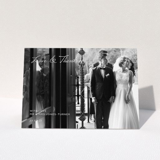 """A wedding thank you card template titled """"To the Left Photo"""". It is an A5 card in a landscape orientation. It is a photographic wedding thank you card with room for 1 photo. """"To the Left Photo"""" is available as a folded card, with mainly white colouring."""