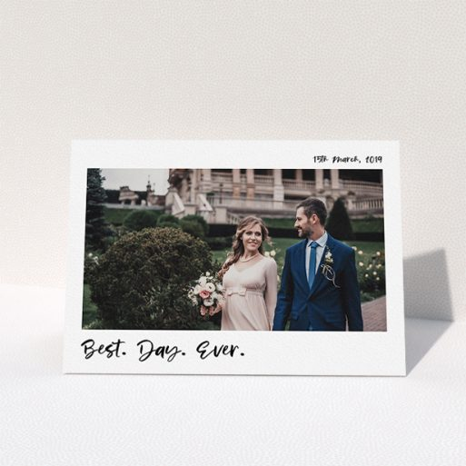 """A wedding thank you card named """"Top and Bottom Thanks"""". It is an A5 card in a landscape orientation. It is a photographic wedding thank you card with room for 1 photo. """"Top and Bottom Thanks"""" is available as a folded card, with mainly white colouring."""