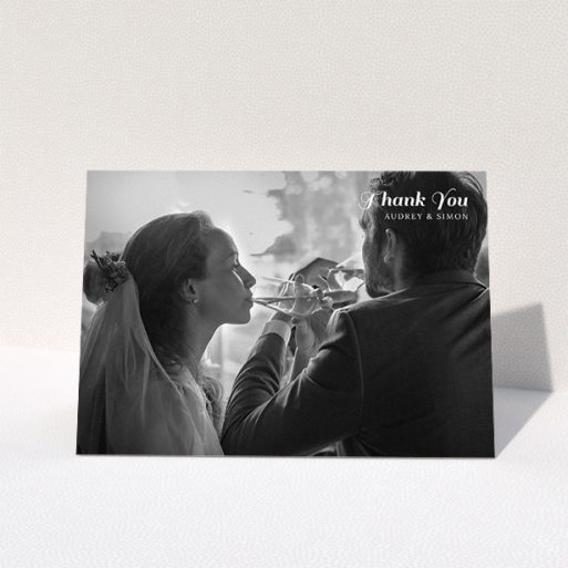 """A wedding thank you card design titled """"Top-Right"""". It is an A5 card in a landscape orientation. It is a photographic wedding thank you card with room for 1 photo. """"Top-Right"""" is available as a folded card, with mainly white colouring."""