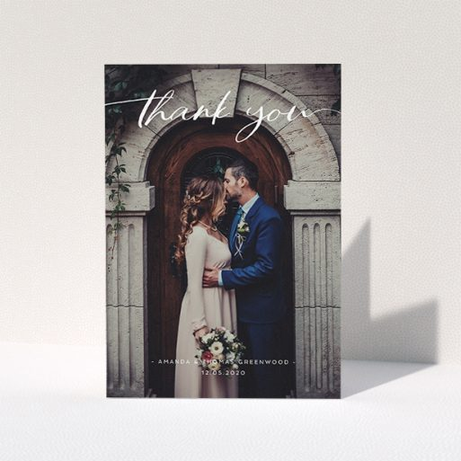 """A wedding thank you card called """"Topped and Bottomed"""". It is an A5 card in a portrait orientation. It is a photographic wedding thank you card with room for 1 photo. """"Topped and Bottomed"""" is available as a folded card, with mainly white colouring."""