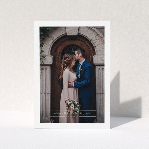 """A wedding thank you card named """"Tramlines"""". It is an A5 card in a portrait orientation. It is a photographic wedding thank you card with room for 1 photo. """"Tramlines"""" is available as a folded card, with mainly white colouring."""