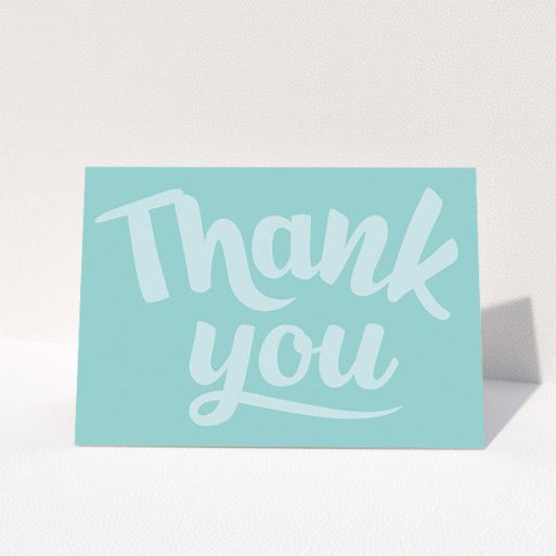 """A wedding thank you card design named """"Typography thank you"""". It is an A5 card in a landscape orientation. """"Typography thank you"""" is available as a folded card, with mainly blue colouring."""