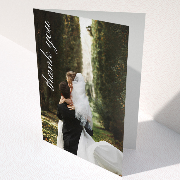 """A wedding thank you card called """"Up the Side"""". It is an A5 card in a portrait orientation. It is a photographic wedding thank you card with room for 1 photo. """"Up the Side"""" is available as a folded card, with mainly white colouring."""