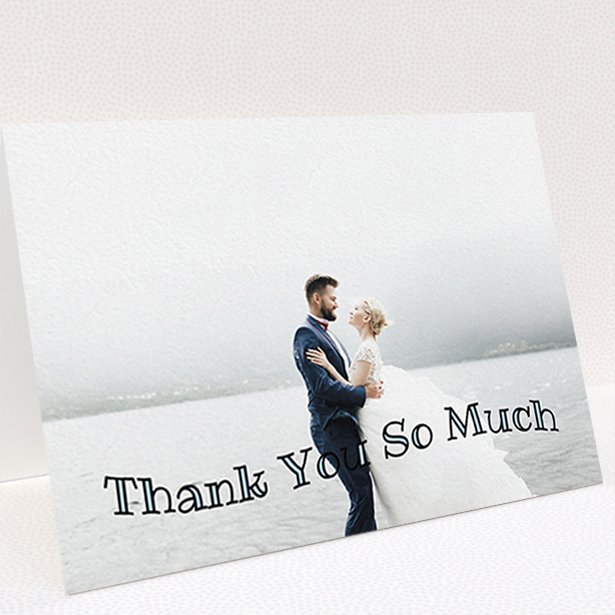 """A wedding thank you card design named """"Wave of Thanks"""". It is an A6 card in a landscape orientation. It is a photographic wedding thank you card with room for 1 photo. """"Wave of Thanks"""" is available as a folded card, with mainly blue colouring."""