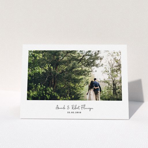 """A wedding thank you card called """"White Space with Photo"""". It is an A5 card in a landscape orientation. It is a photographic wedding thank you card with room for 1 photo. """"White Space with Photo"""" is available as a folded card, with mainly white colouring."""