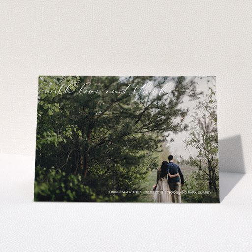 """A wedding thank you card design titled """"With Love And Thanks"""". It is an A5 card in a landscape orientation. It is a photographic wedding thank you card with room for 1 photo. """"With Love And Thanks"""" is available as a folded card, with mainly white colouring."""