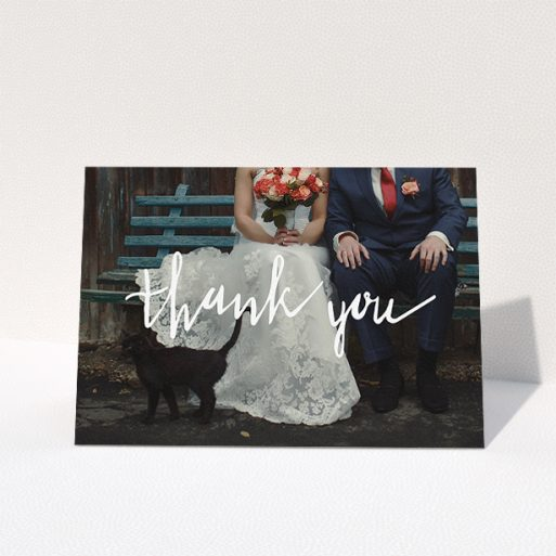 """A wedding thank you card template titled """"Wonky thank you"""". It is an A5 card in a landscape orientation. It is a photographic wedding thank you card with room for 1 photo. """"Wonky thank you"""" is available as a folded card, with mainly white colouring."""