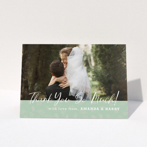 """A wedding thank you card design called """"Woodland Footer"""". It is an A5 card in a landscape orientation. It is a photographic wedding thank you card with room for 1 photo. """"Woodland Footer"""" is available as a folded card, with tones of green and white."""
