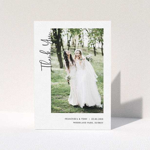 """A wedding thank you card design called """"Written up the Side"""". It is an A5 card in a portrait orientation. It is a photographic wedding thank you card with room for 1 photo. """"Written up the Side"""" is available as a folded card, with mainly white colouring."""